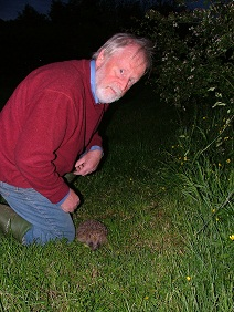 TWIC Chair Alastair Sommerville poses with a hedgehog found in his garden.
